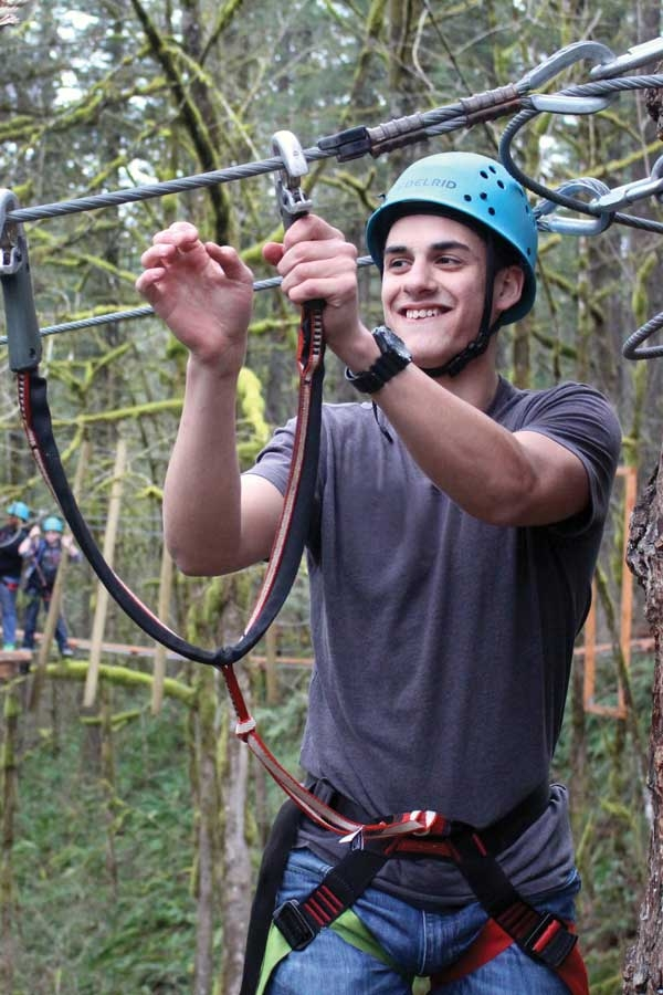 Teen on high ropes