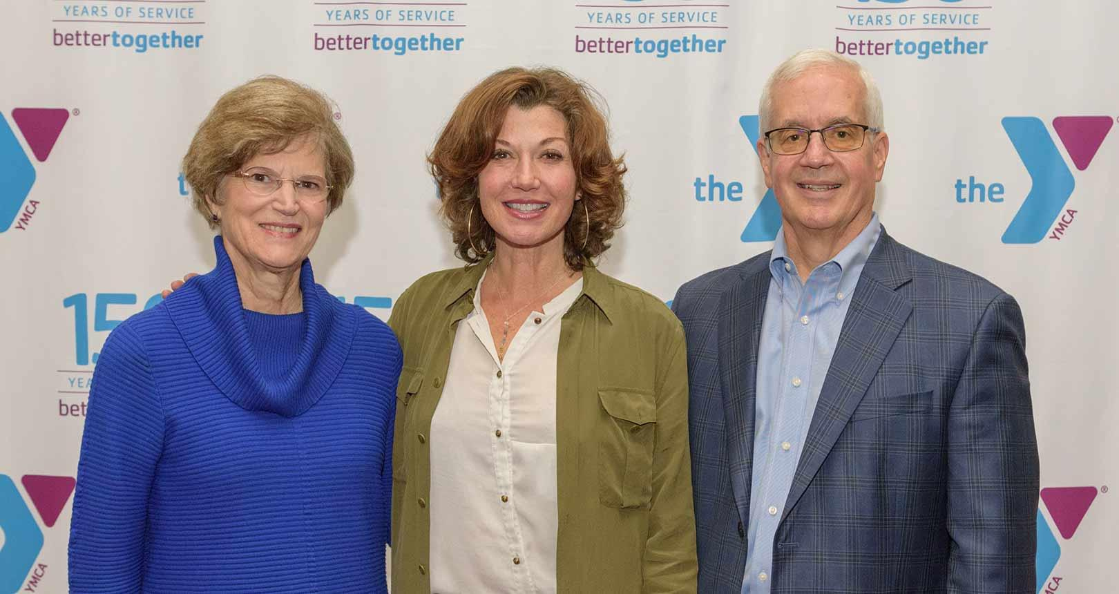 Amy Grant standing with YMCA of Columbia-Willamette CEO, Bob Hall and Board of Trustees Chair, Carol Terrell