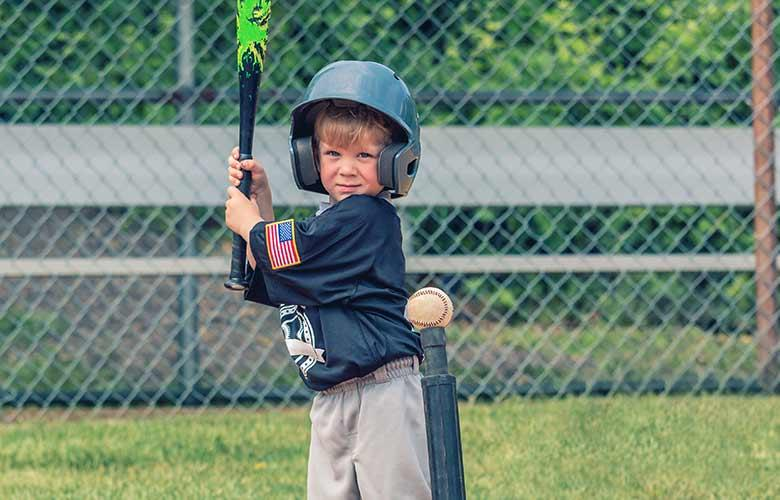 Little boy up to bat for Tball