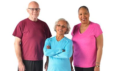 Active older adults stand together smiling
