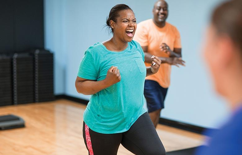 Woman exalts in joy after successful workout