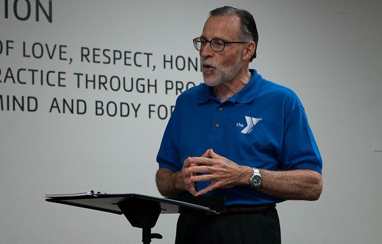 YMCA Chaplain speaks to a room full of employees