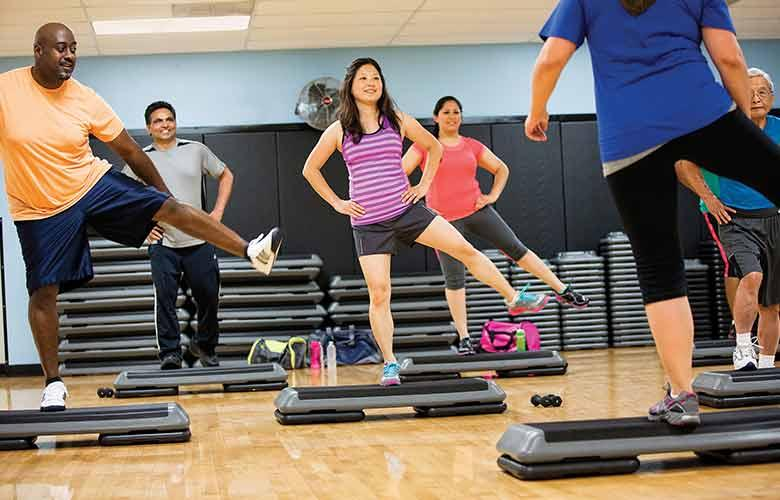 YMCA members participate in a step-aerobics class together