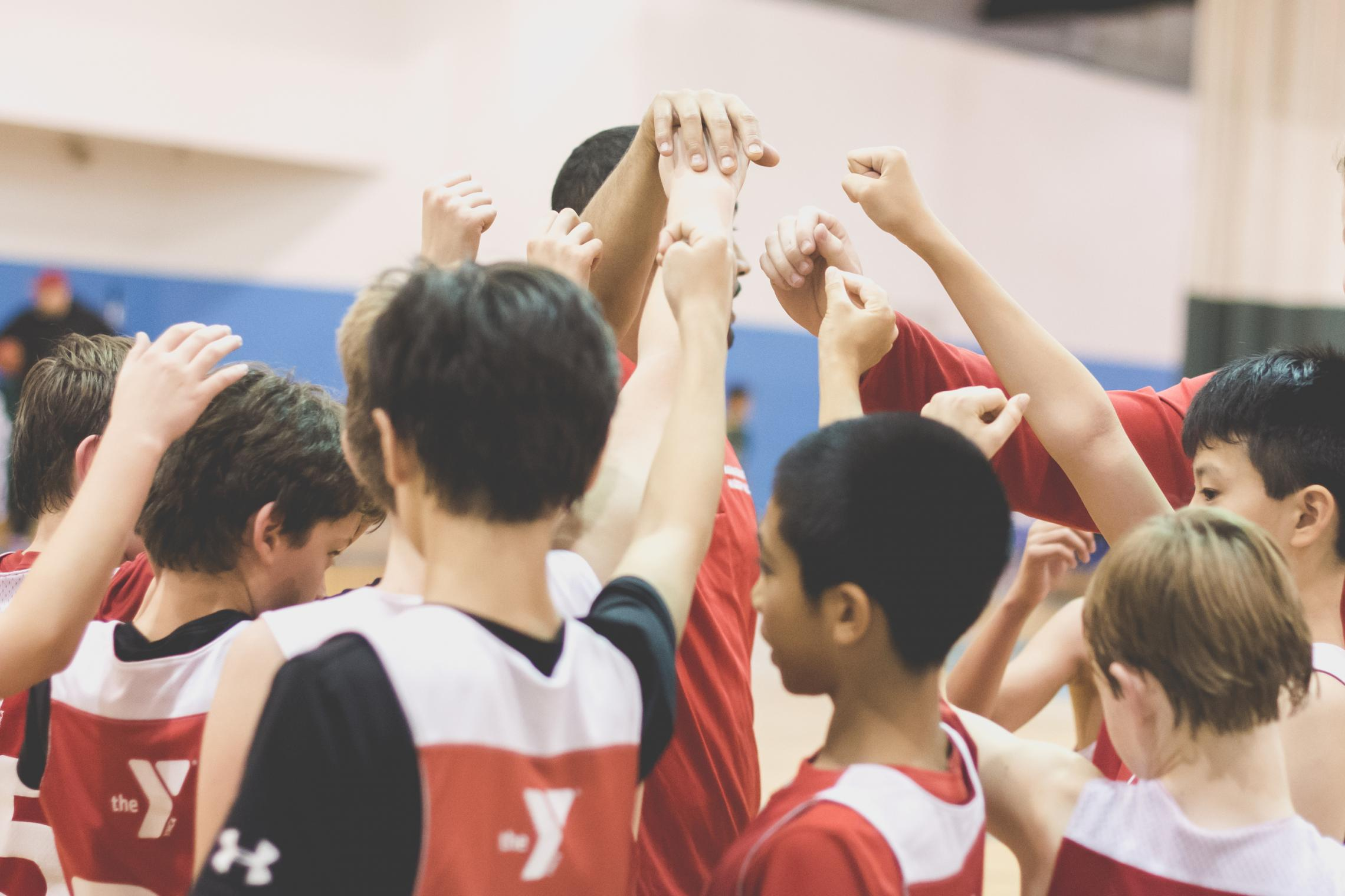 Youth basketball team gathers for huddle