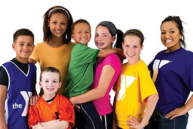 Youth sports players stand together smiling