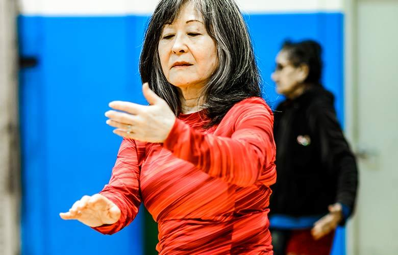 Older woman practicing Tai Chi