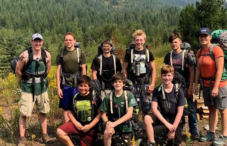 Group of teens and leaders hiking on Mt. Hood