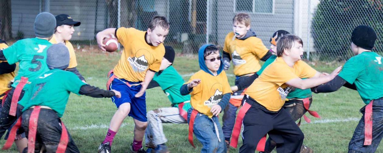 Boys playing flag football
