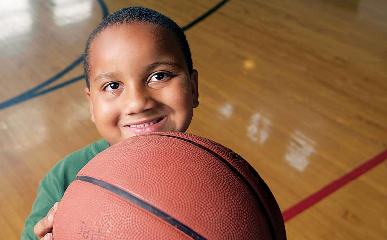 Child holding basketball