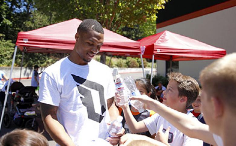 Portland Trailblazers star Damian Lillard at a YMCA basketball camp
