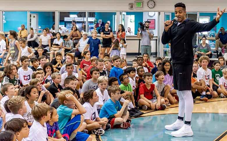 Portland Trailblazers star CJ McCollum works with youth at YMCA basketball camp